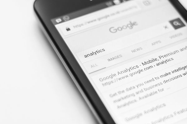 Smartphone showing Google search results for Google Analytics