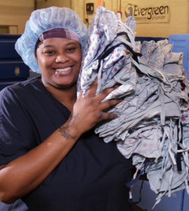 Photo of a smiling, African American female employee of Evergreen Cooperatives