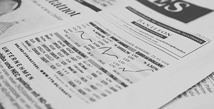 Close-up of financial market charts in a newspaper
