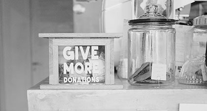 Donation box beside a jar of cookies