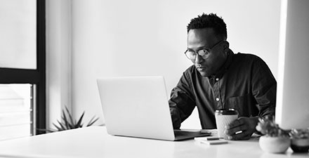 Black man working on a laptop computer