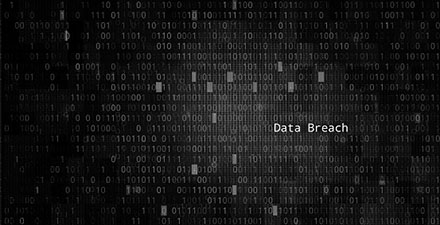 Computer code with the words Data Breach superimposed over it