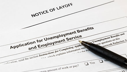 Unemployment application on top of a notice of layoff